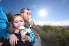 Axel 3 1/2 and Skye Lazet 23 months with grandmother Cathie Jamison enjoy icecreams. Photo/George Novak