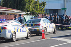 The police cordon at the address where a two-year-old girl was shot. Photo / Jason Oxenham