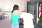 A detergent video screened in China that depicts a housewife putting a black man into a washing machine and retrieving an Asian man after the cleaning cycle. Photo / Supplied