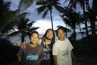 Mal Lakatani, middle, with Niuean locals. Photo / Mal Lakatani