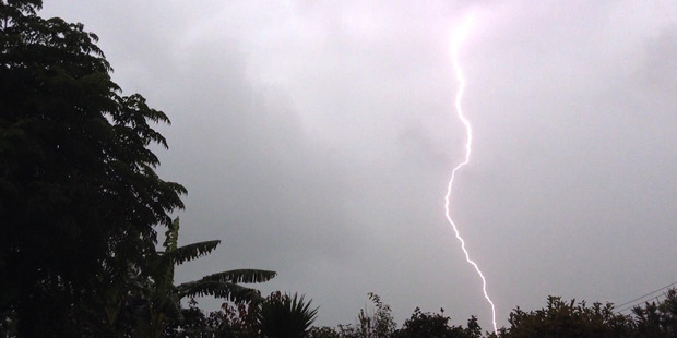 Lightning seen about Riverhead in Northwest Auckland today. Photo / Rachael Parkinson