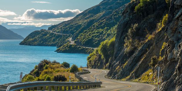 The road alongside Lake Wakatipu delivers stunning views.