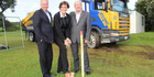 West Coast Hospital Redevelopment Partnership Group chairwoman Cathy Cooney, centre, breaks ground at the hospital site with Peter Ballantyne, right, and Greg Pritchard, left. Photo / Supplied