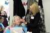 Breast cancer sufferer Louisa Allwood receiving beauty tips from Look Good Feel Better volunteer Gaelene Falconer. Photo/George Novak