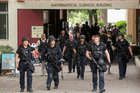 Los Angeles Police officers walk by the Mathematical Sciences Building on the UCLA campus after a fatal shooting. Photo / AP