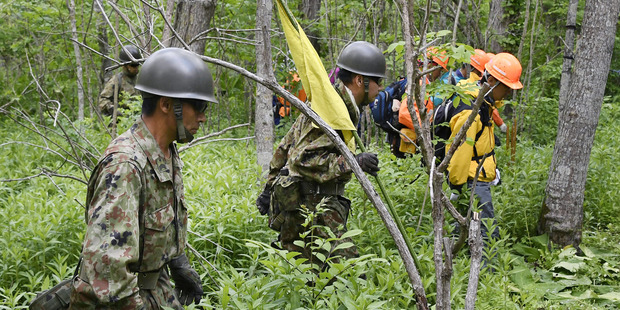 Members of the Ground Self-Defense Force conduct a search operation for Yamato Tanooka. Photo / AP