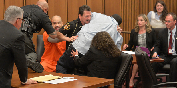 A court officer tackles Van Terry with Ohio serial killer Michael Madison, left. Photo / AP