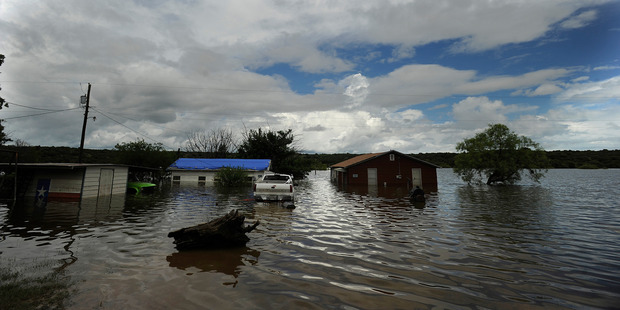 Houses sit in flooded lake waters at Lake Cisco, Texas. Photo / AP
