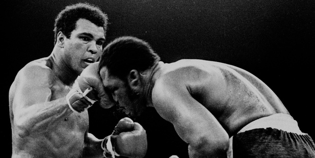 Muhammad Ali throws a right at Joe Frazier in the 13th round in their title bout in Manila, Philippines in 1975. Photo / AP