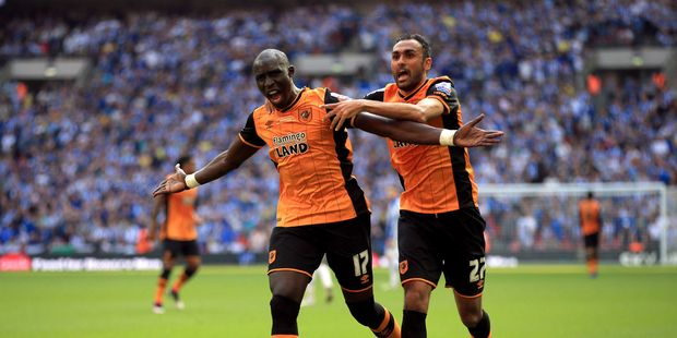 Hull City's Mohamed Diame, left, celebrates scoring his side's first goal of the game with teammate Ahmed Elmohamady. Photo / AP.
