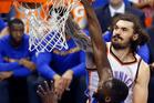 Steven Adams dunks over Golden State Warriors forward Draymond Green. Photo / AP