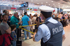 Passengers wait at Terminal 1 at the security area at German airport Cologne-Bonn. Photo / AP