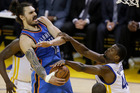 Oklahoma City Thunder center Steven Adams, left, is defended by Golden State Warriors forward Harrison Barnes during the first half of Game 7. Photo / AP.