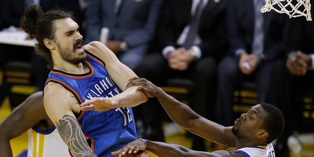 Loading Oklahoma City Thunder center Steven Adams, left, is defended by Golden State Warriors forward Harrison Barnes during the first half of Game 7. Photo / AP.
