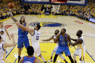 Oklahoma City Thunder's Steven Adams (12) shoots over Andrew Bogut (12) during the first half in Game 7. Photo / AP