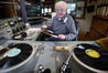 Village Radio technician and panel operator Neil Walsh gets things spinning in this photo from 2014. Photo/file