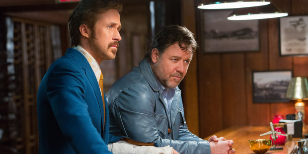 Ryan Gosling as Holland March and Russell Crowe as Jackson Healy in The Nice Guys.