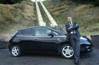 Have Electricity Must Drive. Ross Brown with his plug-in electric car, a Nissan Leaf. Photo/John Borren