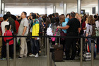 Border control at Auckland International Airport. Photo / Doug Sherring