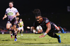 Solomone Kata of the Warriors dives over to score a try. Photo / Getty Images