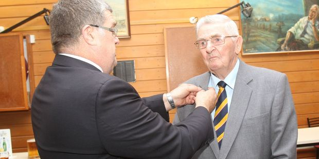 "New Zealand RSA president Barry ""BJ"" Clark pins a merit badge on Masterton RSA member Bevan Hefferen at a small ceremony at the Wairarapa Services and Citizens Club. PHOTO/ANDREW BONALLACK"