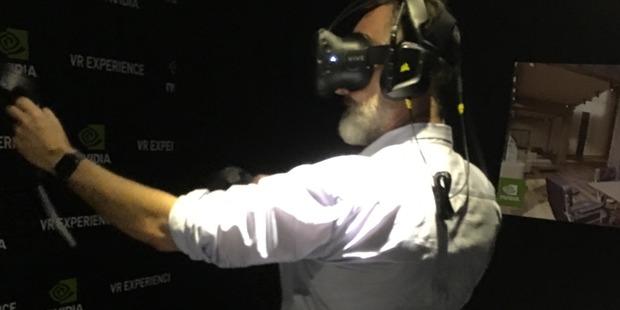 Juha Saarinen trying out virtual reality.
