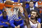 Oklahoma City Thunder center Steven Adams dunks over Golden State Warriors forward Draymond Green. Photo / AP