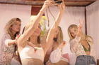 The Victoria's Secret Angels take a selfie pool-side.