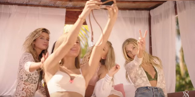 The Victoria's Secret Angels take a selfie pool-side.