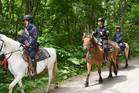 Rescuers on horseback search for a 7-year-old boy who is missing in a Japanese forest in Nanae town, on Hokkaido. Photo / AP