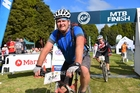 Aaron Watkin finishes the T42 mountain bike race in one piece after being airlifted to hospital the previous year. Photo / Allan Ure