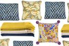 Here are our favourite throws and cushions to get cosy amongst this winter.