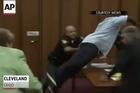 The father of one of three victims of an Ohio serial killer has leaped over a table to attack the defendant in court just minutes after the judge pronounced a death sentence.