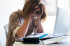 Worried New Zealanders living overseas fear being arrested over student loan debt when they set foot back in the country. Photo / iStock