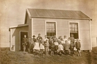 A photo of the former school and students circa 1921/1922.