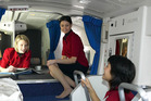 Flight attendants are pictured chatting and relaxing inside the Crew Rest Department on a Boeing 777. Photo / Boeing