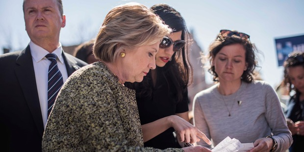 Senior staffer Huma Abedin with Democratic presidential candidate Hillary Clinton in Brooklyn, New York in April this year. Photo / Washington Post