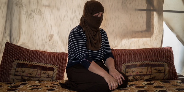 A Yazidi who had been held by Isis militants as a slave for several months sits in a tent outside Duhok, Iraq. Photo / Washington Post