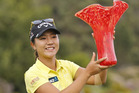 Lydia Ko holds up the winner's trophy after her four shot victory at the Kia Classic. Photo / AP