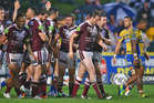 Manly players celebrate a try during last year's clash against the Eels. Photo / Getty