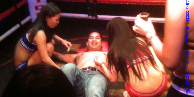 Navy Cmdr. Michael Misiewicz, center, lies flat on his back in a boxing ring during 'Fight Night' at a Manila nightclub. He said Francis mentored him and acted like a big brother. Photo / Supplied