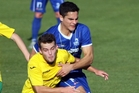 Canaries player Jared Mitchell (left) and Rovers midfielder Josh Stevenson keep each other in check. Photo / Paul Taylor