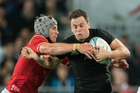 Ben Smith is tackled by Jonathan Davies. Photo / Greg Bowker