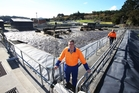 Adam Twose, foreground, says a de-tuned V8 engine will see effluent turned into useful energy at the Whangarei Wastewater Treatment Plant. Photo / Michael Cunningham