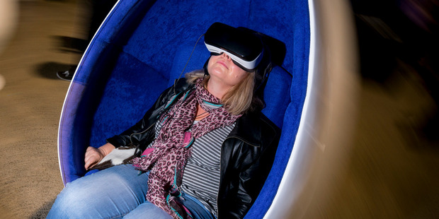 Documentary editor Miriama Toms tries out the Samsung VR set-up during the virtual reality conference held at MOTAT in Auckland. Photo / Dean Purcell