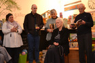 AT PAIGE'S: Author Saisy Gilbert (seated) while husband Garth (right) reads an excerpt from her novel. Also present are Victoria Campbell (left), Brian Gilbert and Lesley Stead. PICTURE / PAUL BROOKS