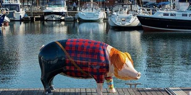 The flannel-wearing, red-haired pig is the pork of the town with fans trotting to the statue in droves to snap a swine selfie. Photo / Suffolk City Council Twitter