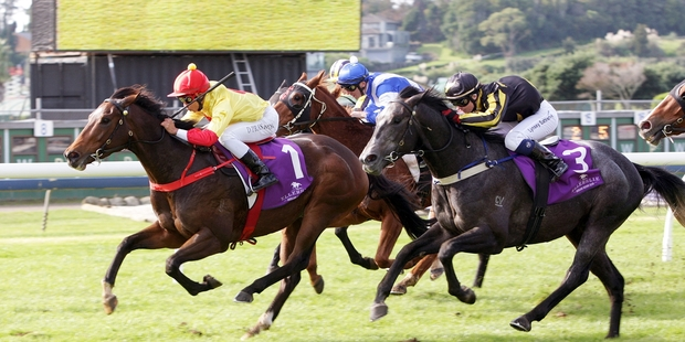 Fire Jet, with Doni Prastiyou in the saddle, narrowly holds on from the fast-closing Battle Time. Photo / Trish Dunell