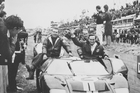 A jubilant Chris Amon waves to the crowd after he and Bruce McLaren won the 1966 24 Hours of Le Mans. Photo / AP