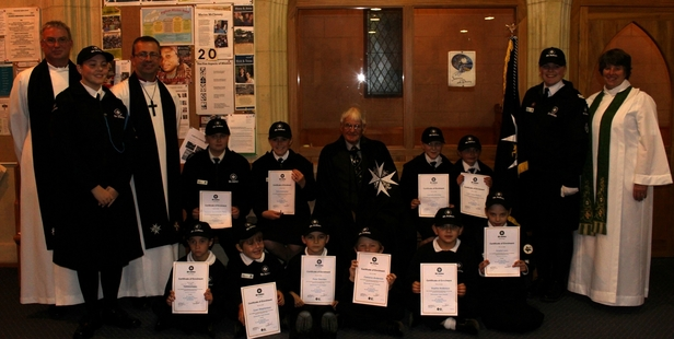 Trevor Dick, a Knight of the Order of St John (centre back) with Dannevirke St John cadets and clergy at the enrolment of cadets at St John the Baptist Anglican Church on Tuesday night. Photo / Christine McKay